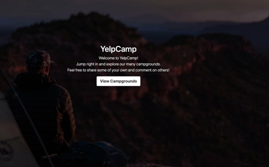 Yelp Camp landing page with panoramic photo of person looking at mountain vista