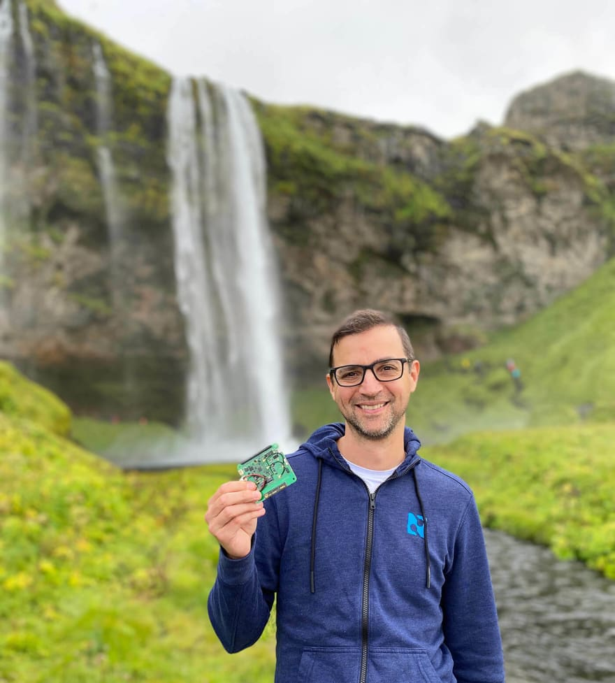 notecard in front of waterfall