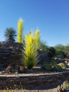 Spiky green glass sculptures that echo the shapes of desert plants.