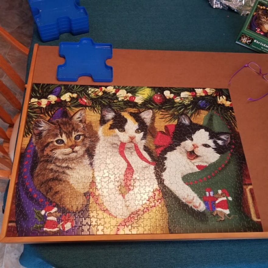 Jigsaw puzzle of three kittens in Christmas stockings