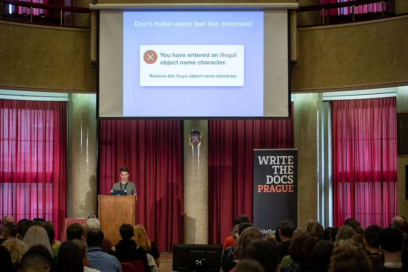 Photo of me speaking at Write the Docs conference in Prague