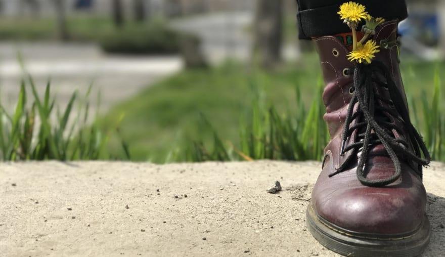 Boots and flowers from [unsplash](https://unsplash.com/photos/szHQOklNOL8) by [Sarvenaz Sorour](https://unsplash.com/@sarvenazsorour)