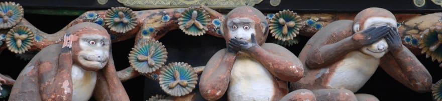 "photo of ""three wise monkeys"" sculpture"