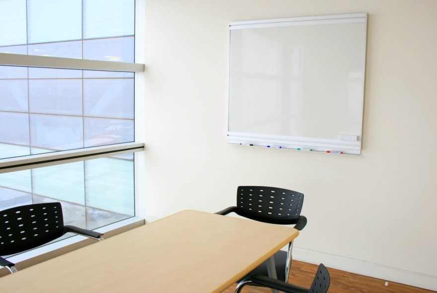 Interview room with two chairs and a whiteboard