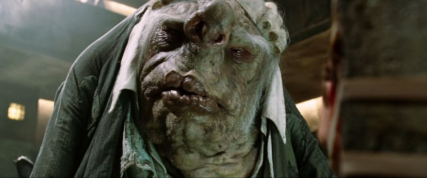 Screenshot from the movie The HitchHicker's Guide to the Galaxy, showing a Vogon; a really ugly alien race known for their love of bureaucracy and their poor poetry skills