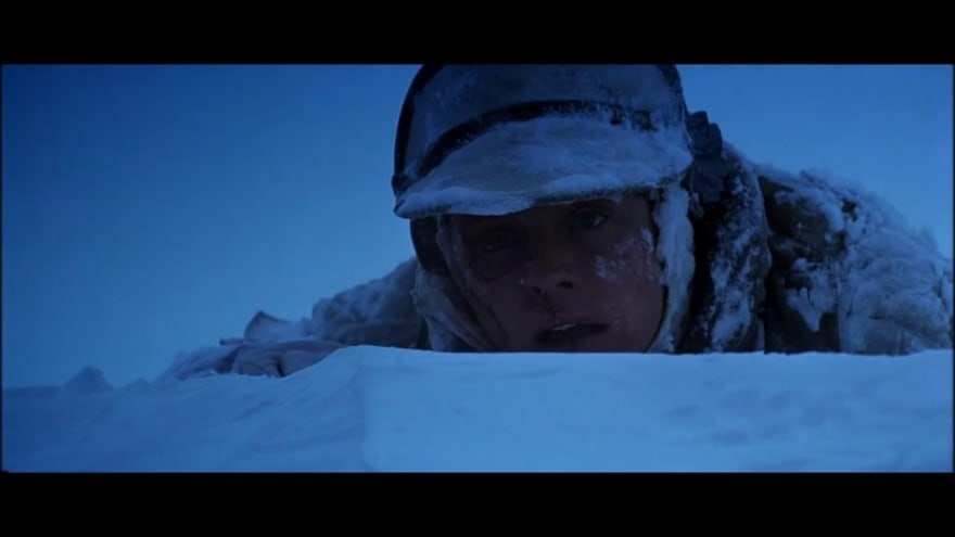Luke Skywalker laying in the snow of Hoth, nearly dead.