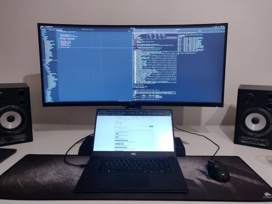 Ultrawide monitor and notebook.