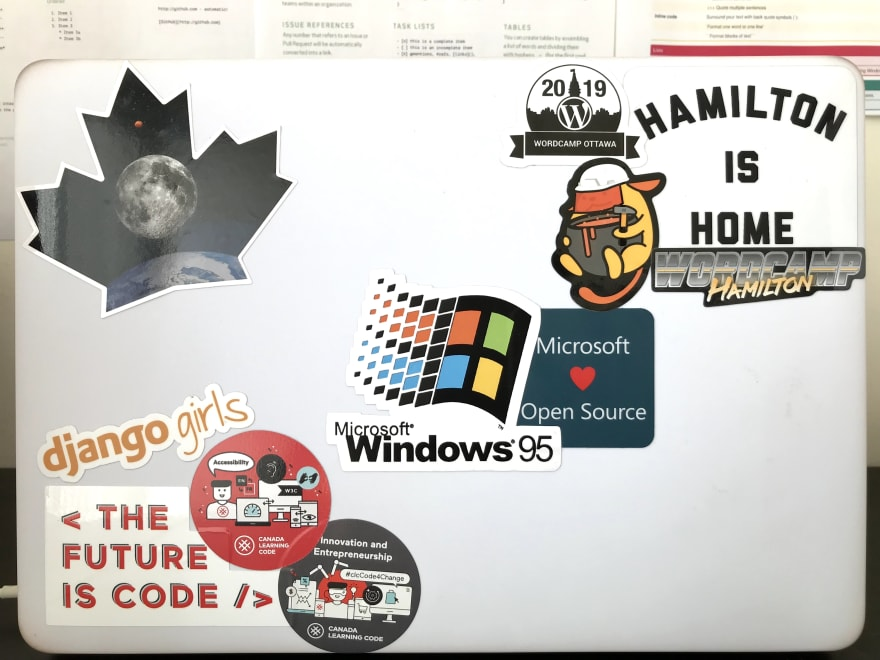 My MacBook with windows 50 sticker on it