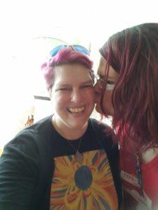 Megan kissing Heidi on the cheek