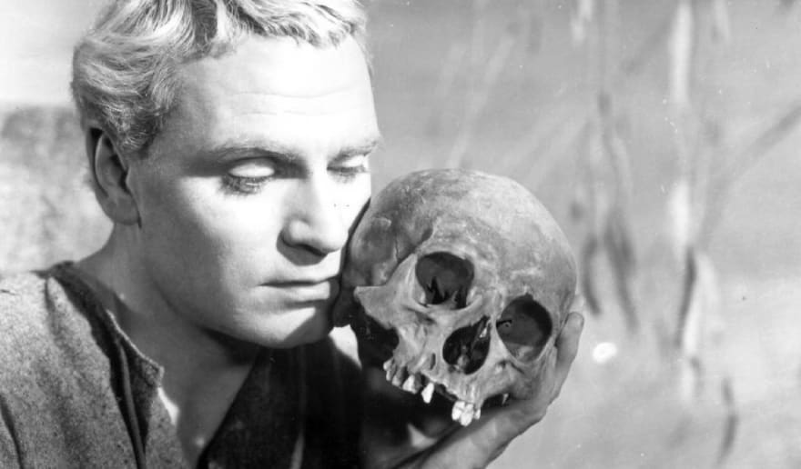 Laurence Olivier as Hamlet holding the skull