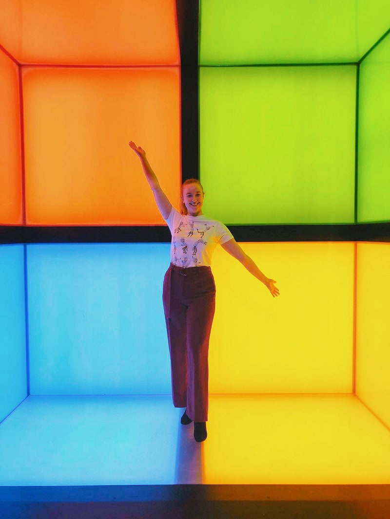 Megan in front of the Microsoft logo