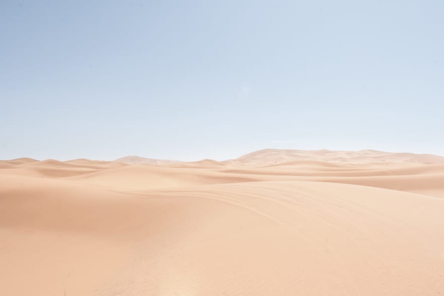 An uninhabited sandy desert stretches into the distance
