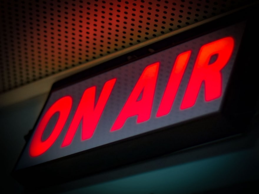 "sign indicating ""on air"" for a TV broadcast."