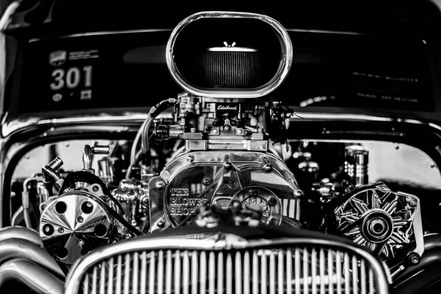 grayscale photography of vintage car engine