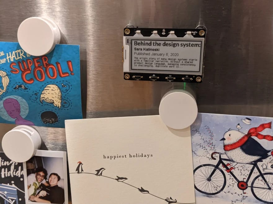 Photo of the magtag displaying Contentful blog on the fridge