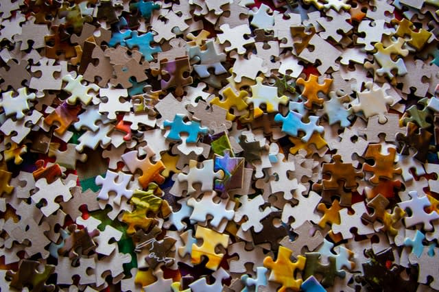 pile of hundreds of puzzle pieces