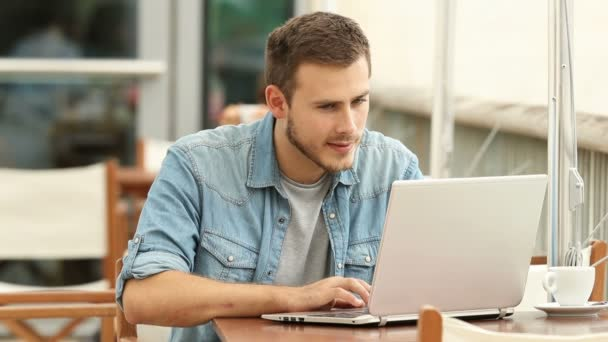 Guy reading from a laptop