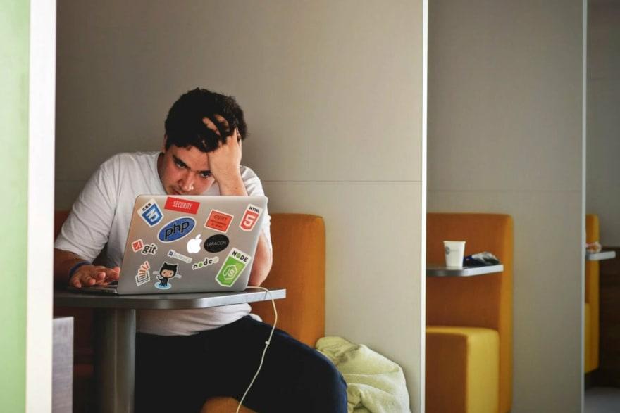 Man looks desperately at computer