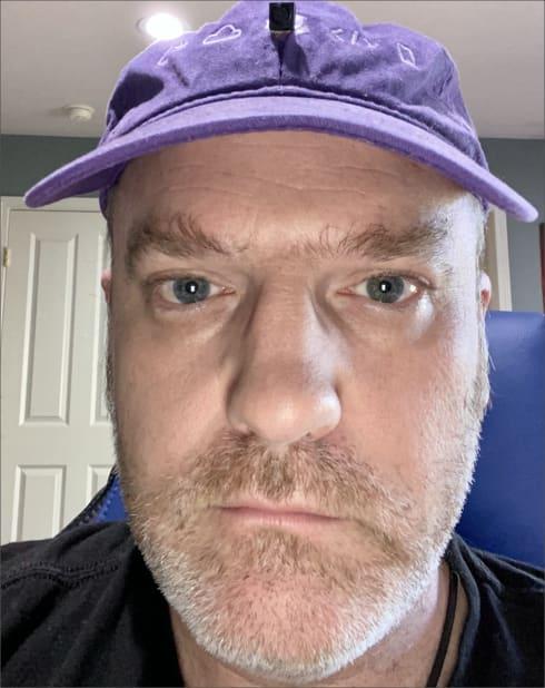 Jim wearing a hat cam