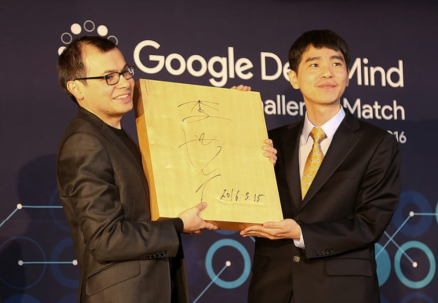 Demis and Lee Sedol hold up the signed Go board from the Google DeepMind Challenge Match