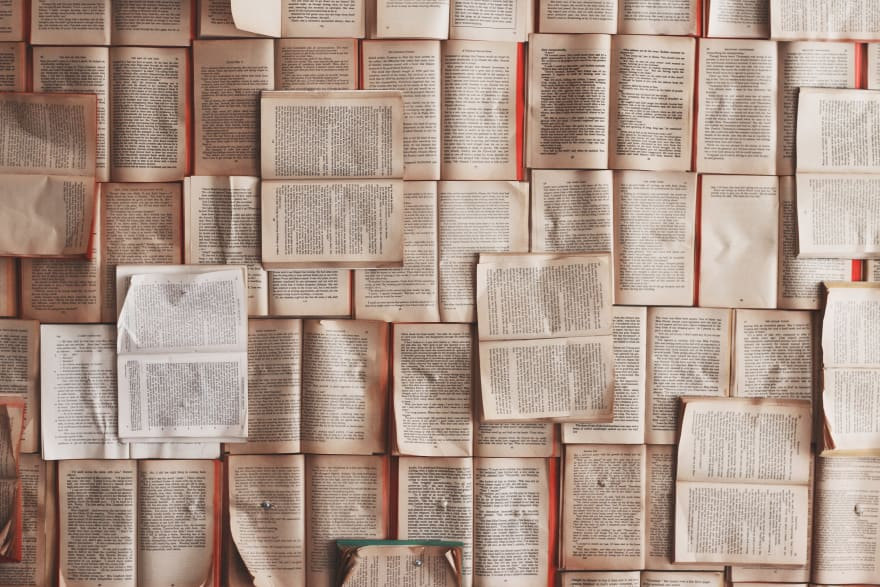 A photo of a lot open books, nicely aligned, taken at FIKA Cafe, Toronto, Canada