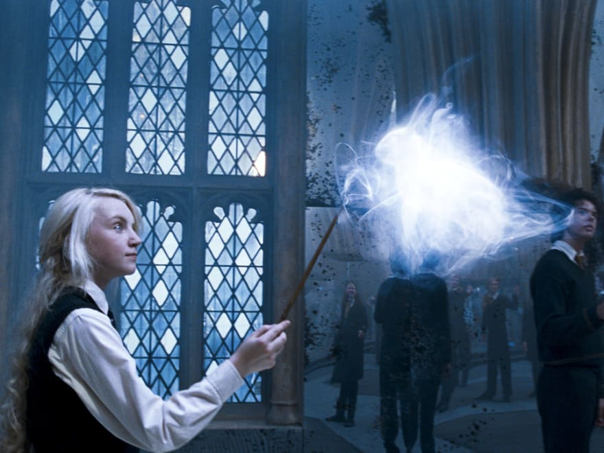 Luna Lovegood from Harry Potter casting Patronus spell