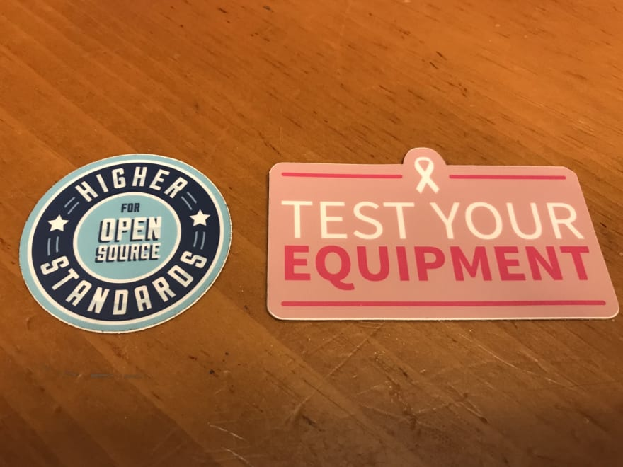 """the one on the left says """"higher standards for open source"""". The one on the right says """"Test your equipment"""""""