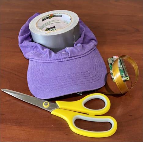 All the parts - cap, gaffer tape, scissors, pi, camera