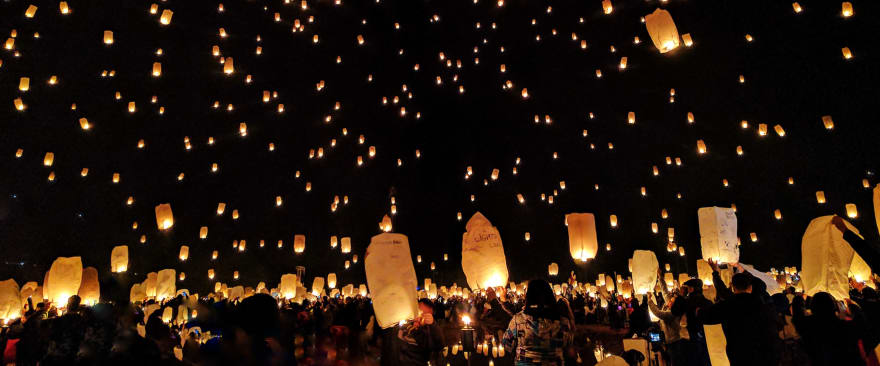 Lanterns at night floating into the sky