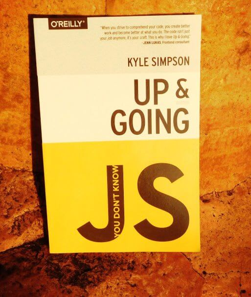 cover of book You Don't Know JavaScript: Up & Going by Kyle Simpson sitting on a rock