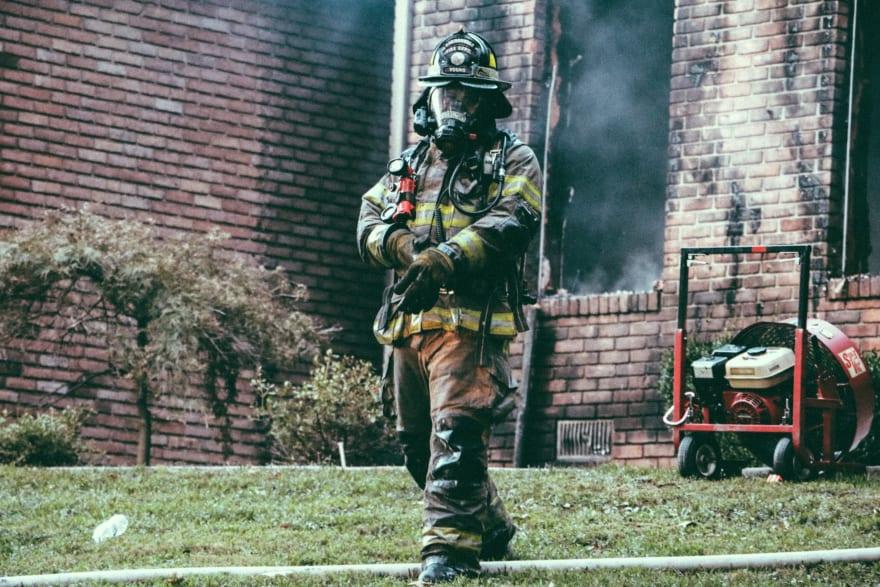 Photo by [Andrew Gaines](https://cdn.hashnode.com/res/hashnode/image/upload/v1614109141743/DGA-e4Svf.html) on [Unsplash](https://unsplash.com/s/photos/firefighter?utm_source=unsplash&utm_medium=referral&utm_content=creditCopyText)