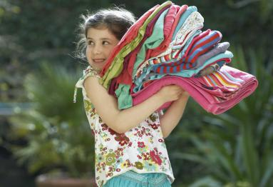girl carrying clothes