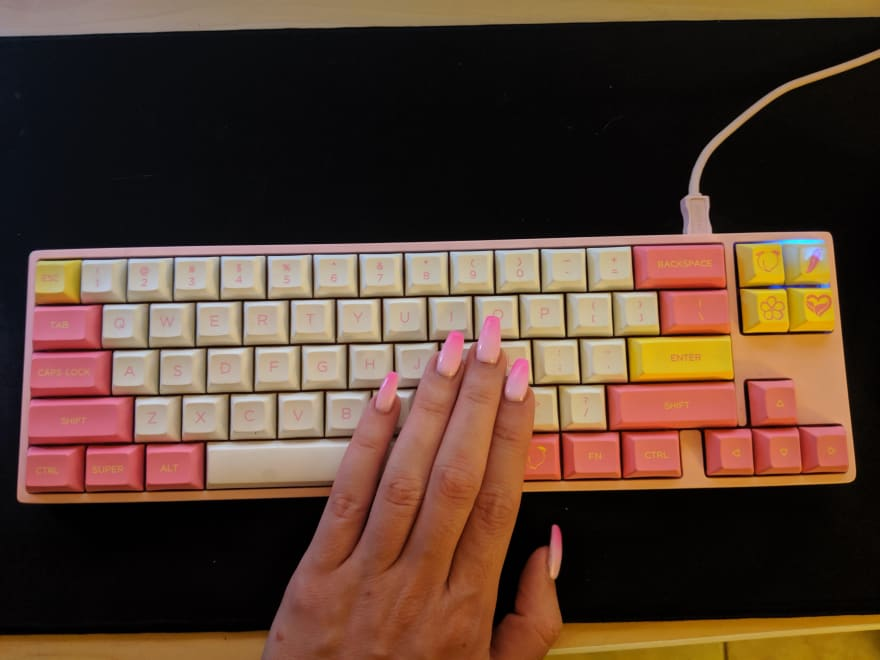 my gradient pink nails in front of my pink mechanical keyboard