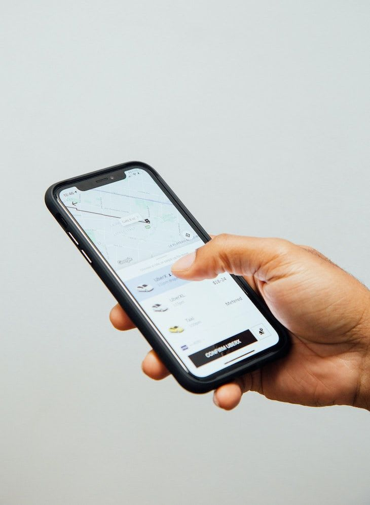 A smartphone with an Uber app open