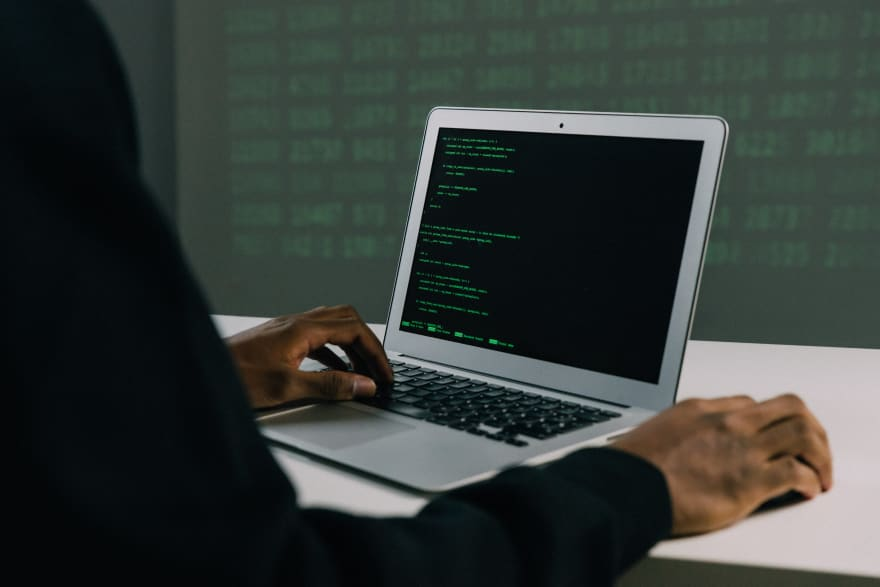 person coding on laptop