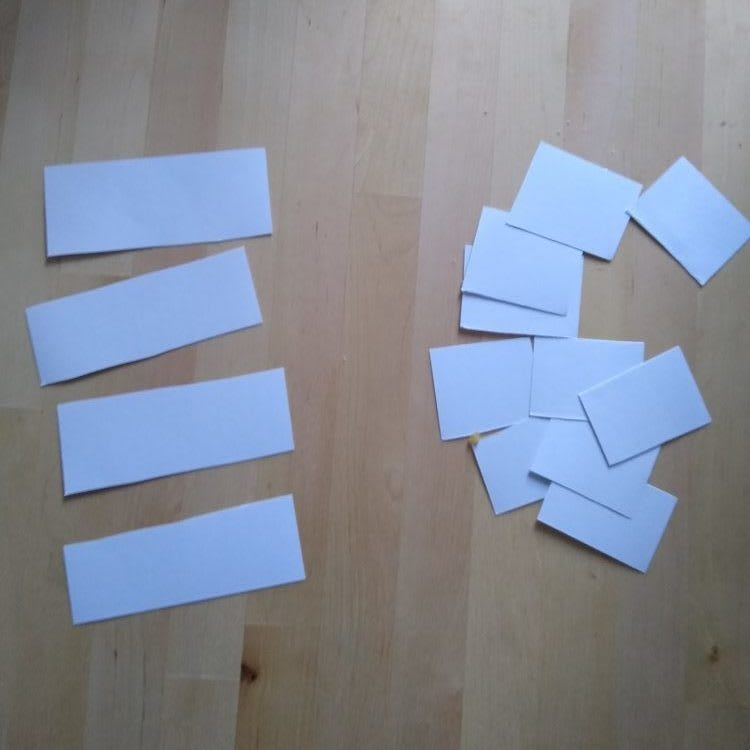 Slips of paper cut to two different sizes