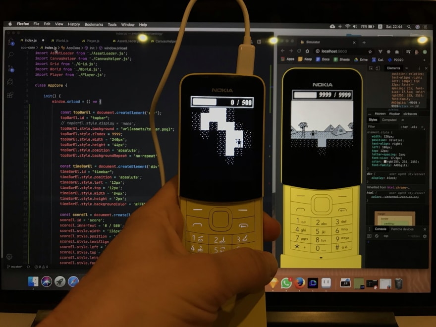 Photo of real phone and computer showing implemented mockup