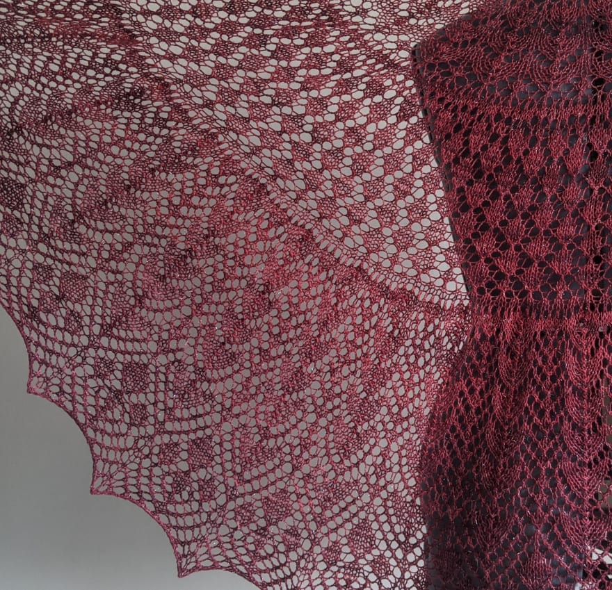 Dowland shawl knit in sparkly burgundy yarn