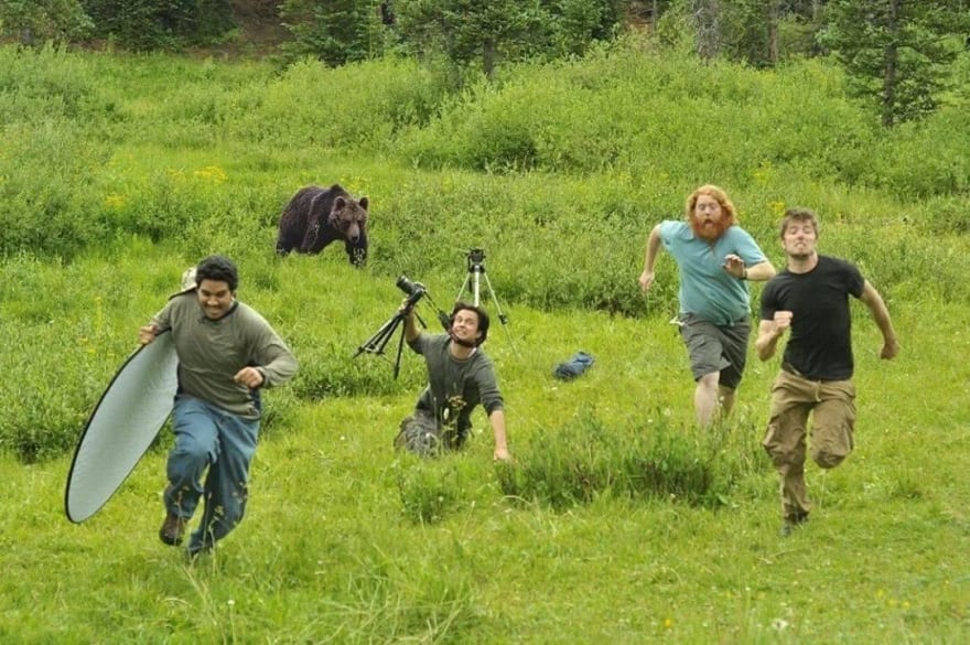 Men running from a charging bear. One has tripped. He is doomed.
