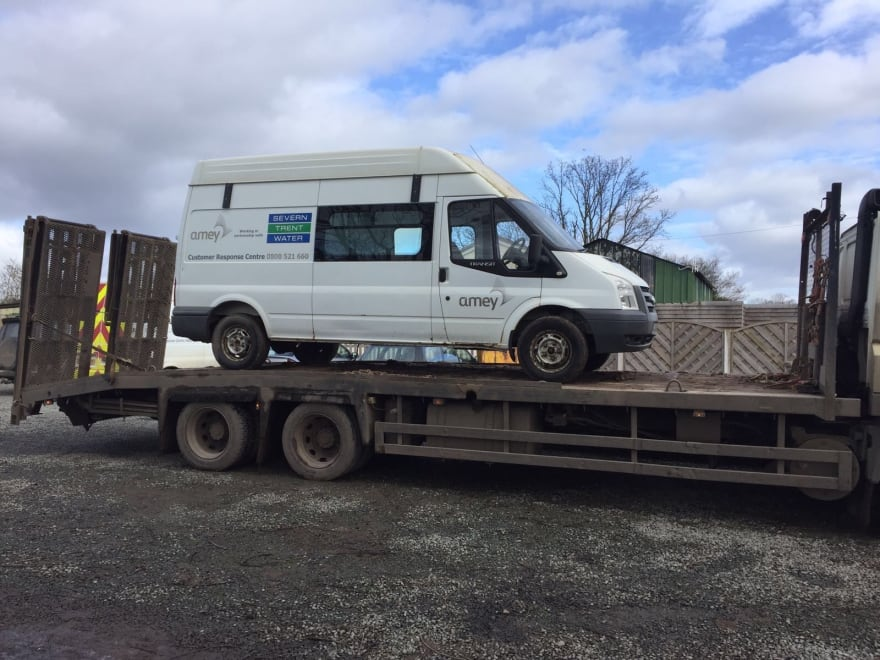 image of van on pickup truck bed