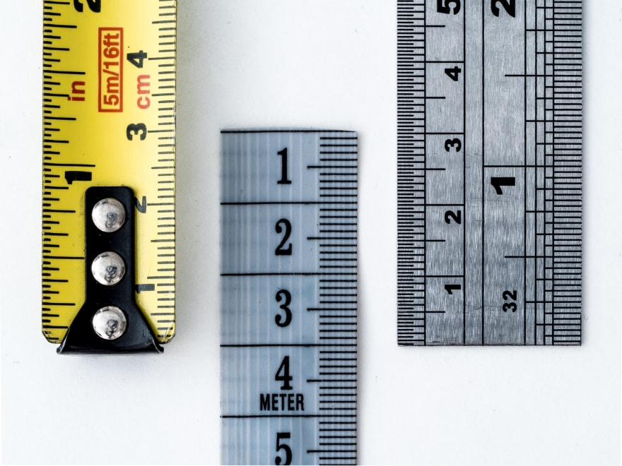 Macro of various tape measures and rulers, created for a weekly challenge on the Flickr Macro Mondays group
