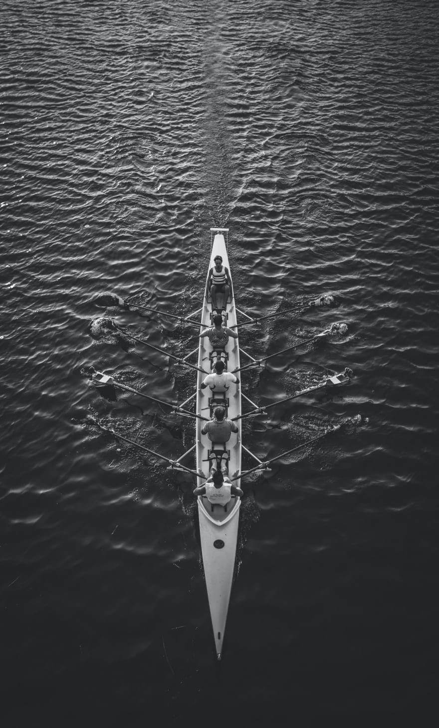 people riding boat on body of water photo