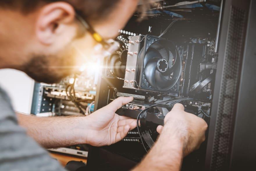 man inspecting computer