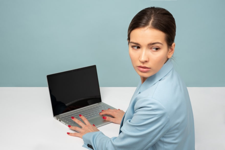 Worried employee looking over her shoulder