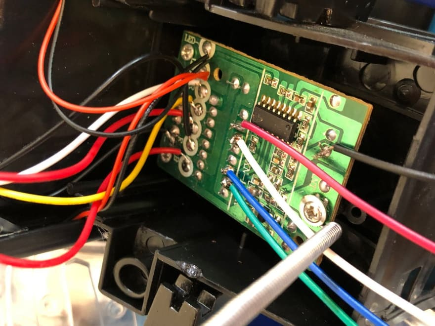 Image of inserting the motor controller back into the Tumbler chassis.