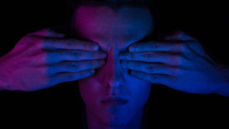 person covering their eyes relying on integrity of others
