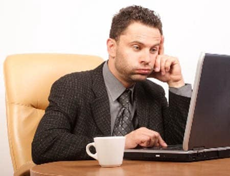Man looking at a computer frustrated