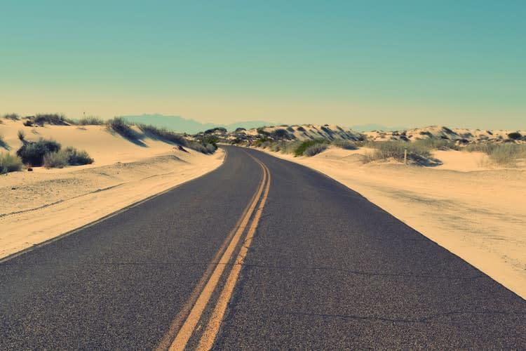 road running through desert terrain