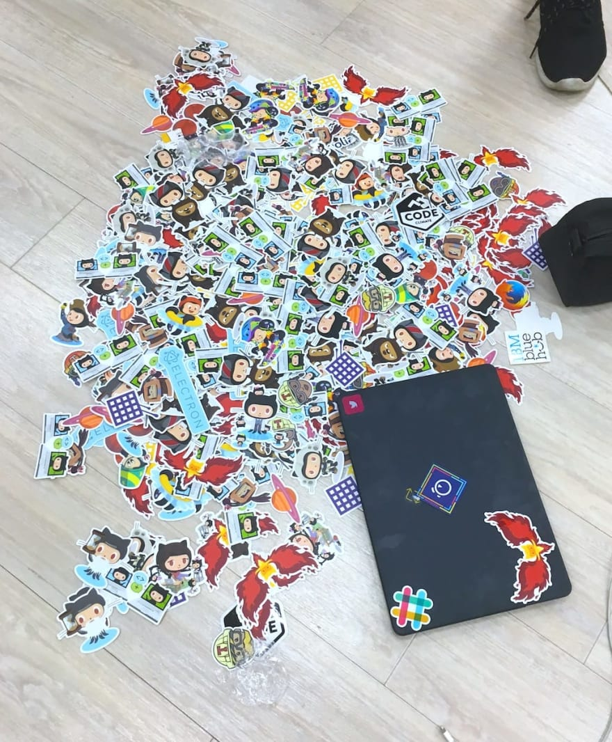 Github (and others) stickers on the floor, at DevRelCon Tokyo 2017