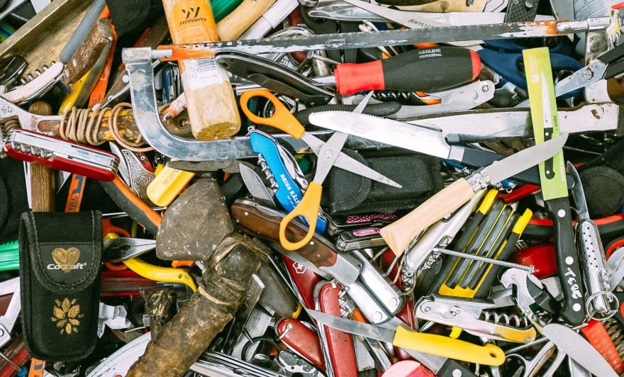image of a cluttered pile of work tools